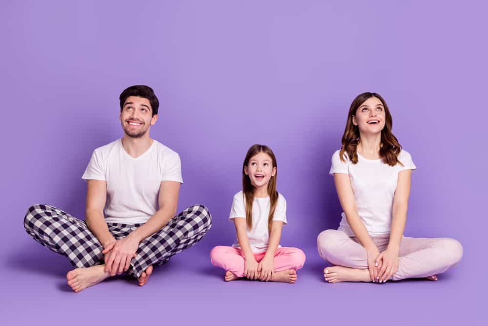 A family wearing pajamas and white shirts.