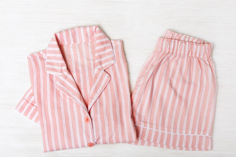 This is a close look at a set of peach striped classic pajamas.