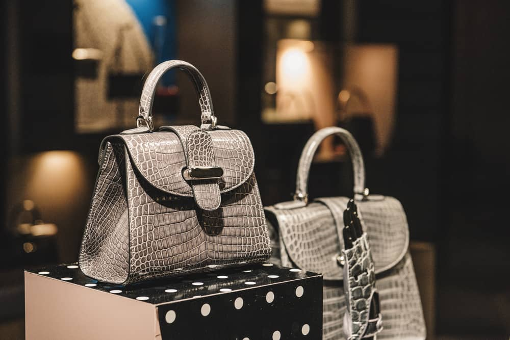 This is a close look at a couple of hand bags on display at a store.