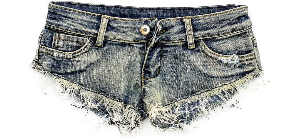 This is a close look at a pair of frayed jean shorts.