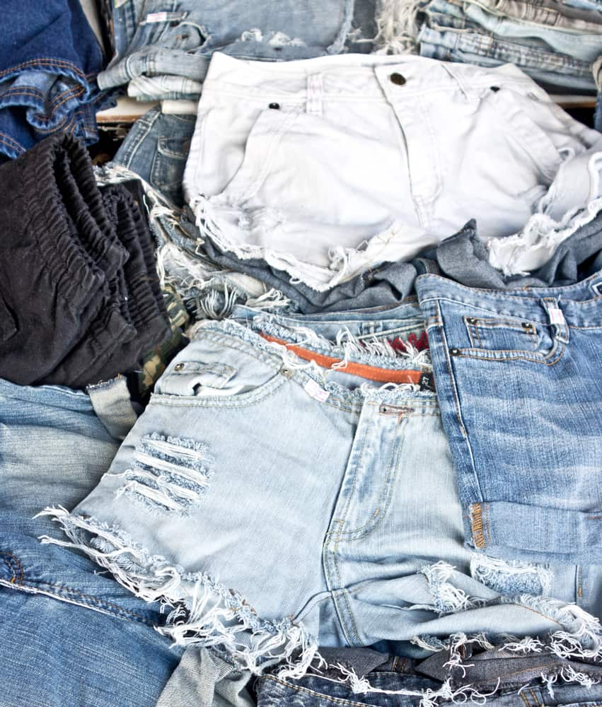 This is a close look at a bunch of frayed and distressed jean shorts.