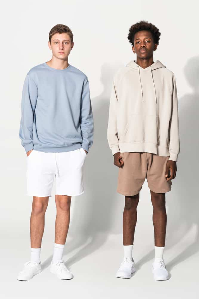 Two teen guys wearing shorts and socks with their outfits.