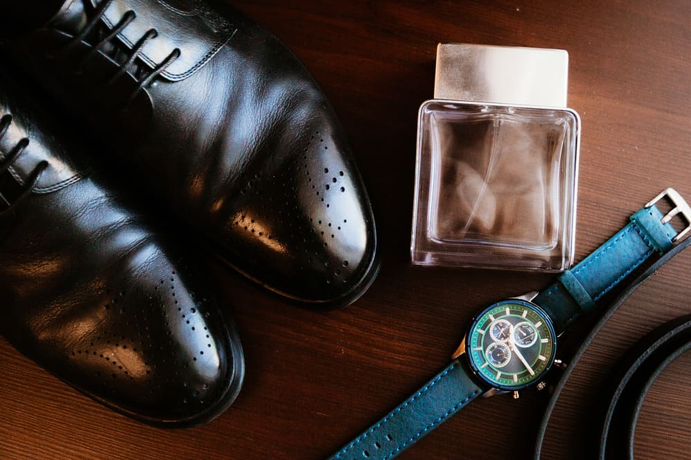 Men's accessories over a wooden table.