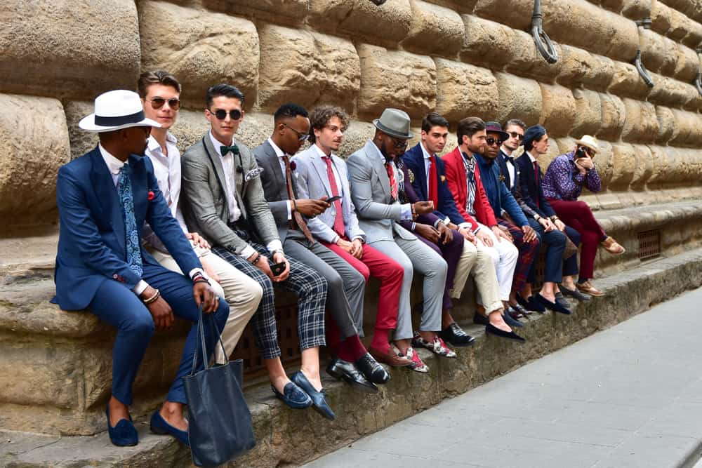 A group of men wearing fashionable outfits during fashion fair.