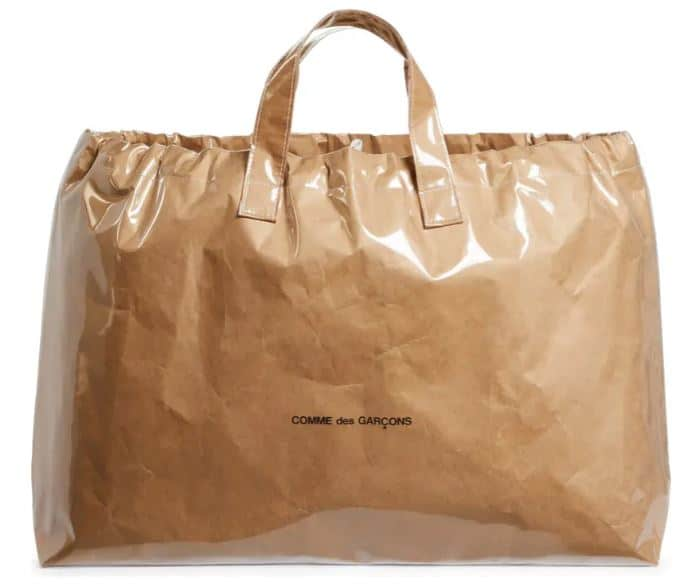 The Comme De Garcons Logo Kraft Paper Tote from Nordstrom.