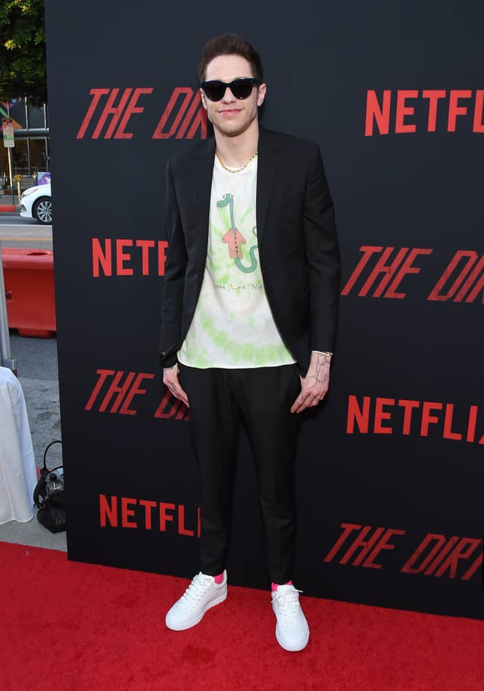 Pete Davidson in scrumbro outfit attends the Netflix 'The Dirt' Premiere.
