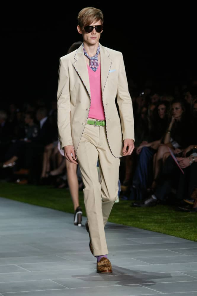 Model in Sloane ranger clothes walks the runway.