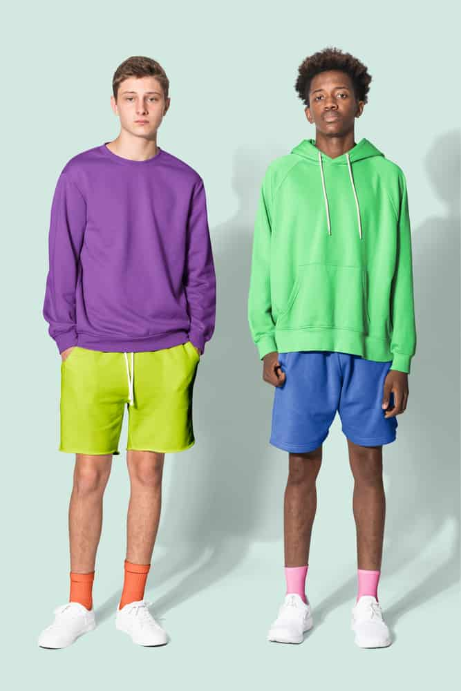 Teenage boys wearing colorful sweaters and shorts.