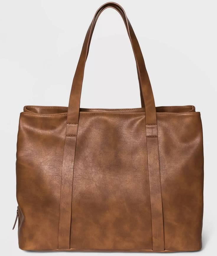 The brown leather triple compartment tote handbag from Target.