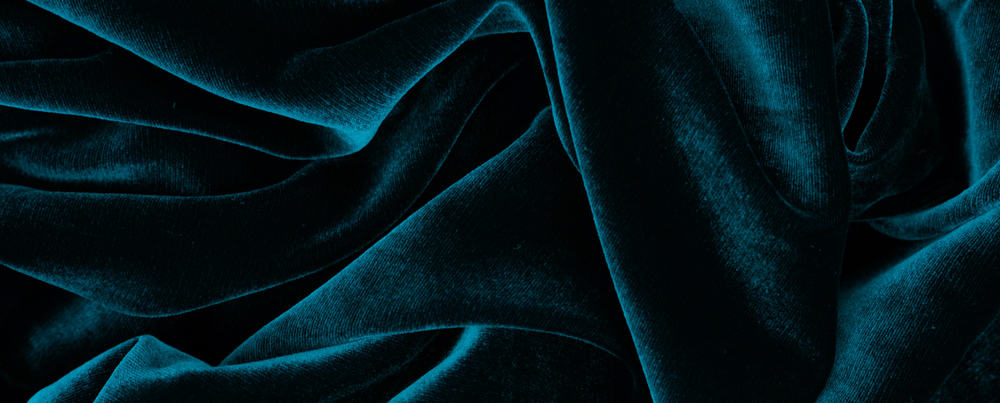 This is a close look at a dark green velvet fabric.