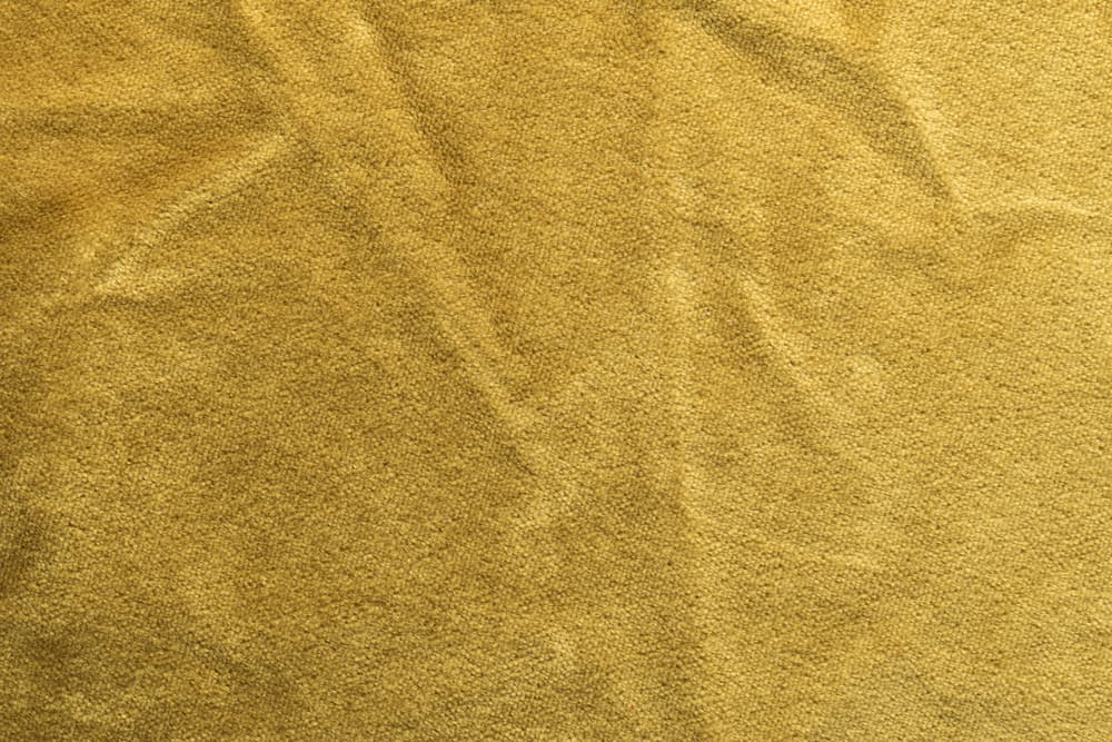 This is a close look at a golden mohair velvet fabric.