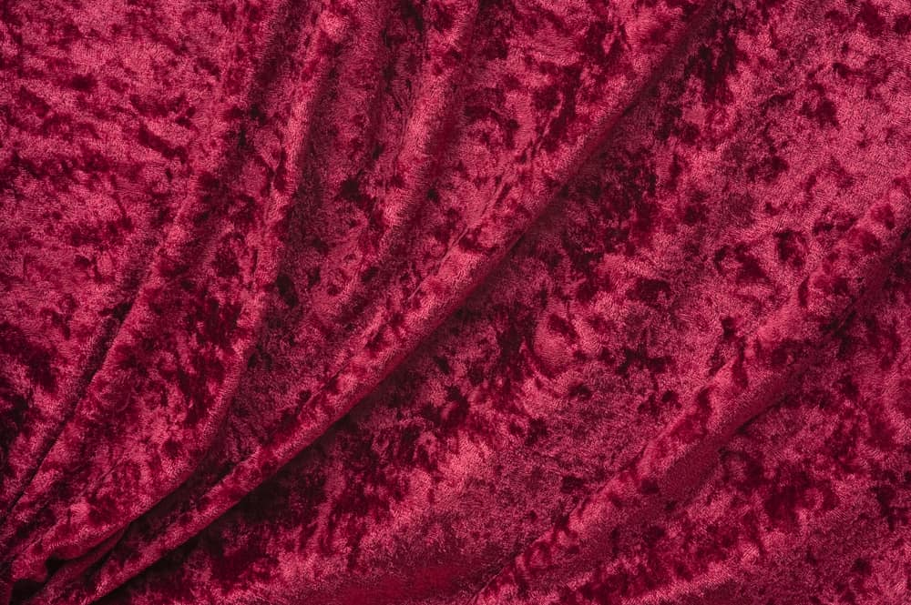 This is a close look at a crimson crushed velvet fabric.