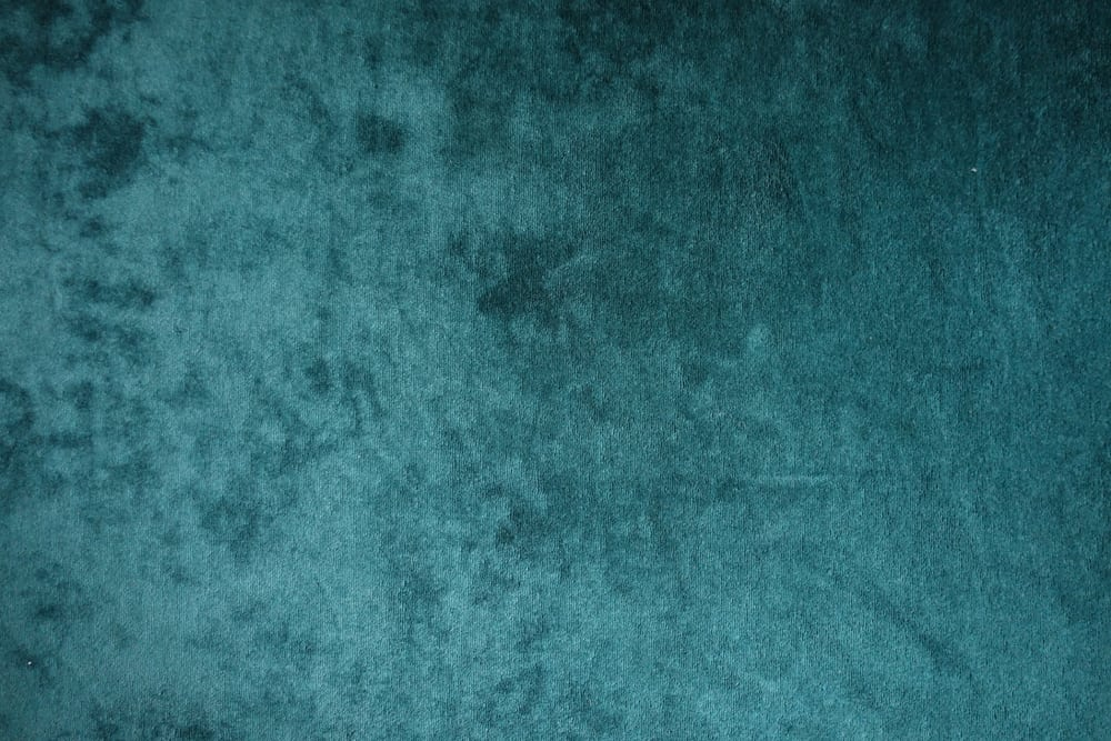 This is a close look at a dark green plain velvet fabric.