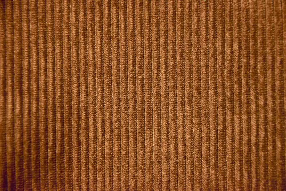 This is a dark brown corduroy velvet fabric.