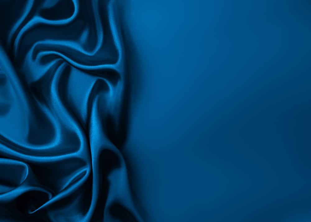 This is a close look at a dark blue rayon and silk velvet fabric.