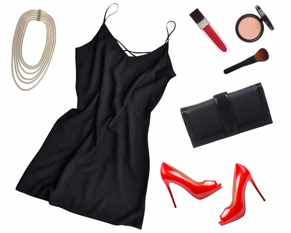 This is a close look at a little black dress surrounded by various accessories.