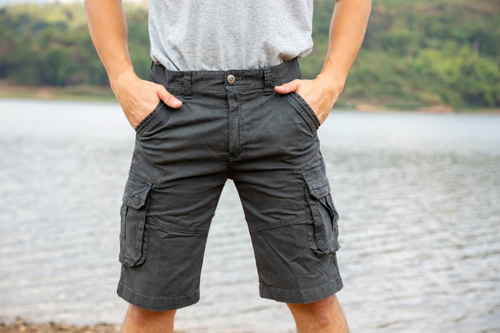 This is a close look at a man wearing a pair of cargo Bermuda shorts.