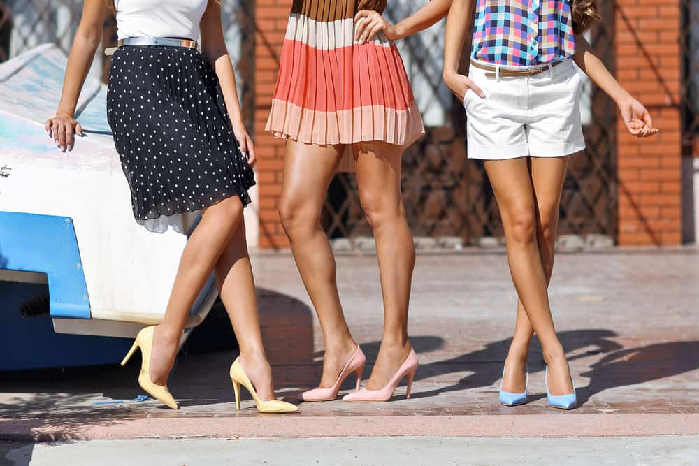 This is a close look at three friends wearing various outfits of the same length.