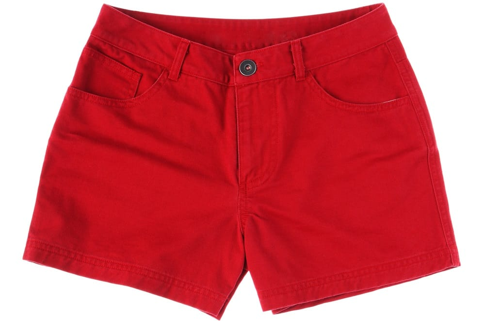 This is a close look at a pair of red jean shorts.