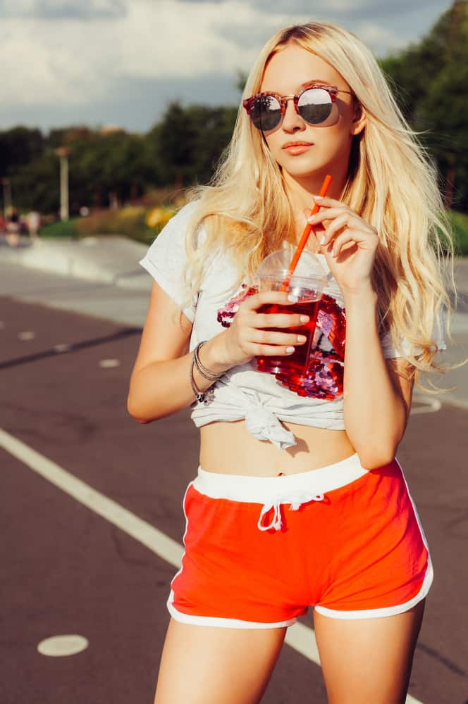 This is a close look at a woman wearing a pair of red short shorts.
