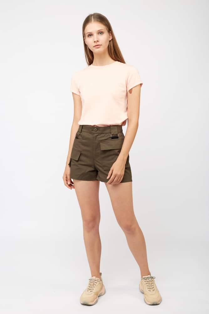 A woman wearing a pair of cargo shorts.