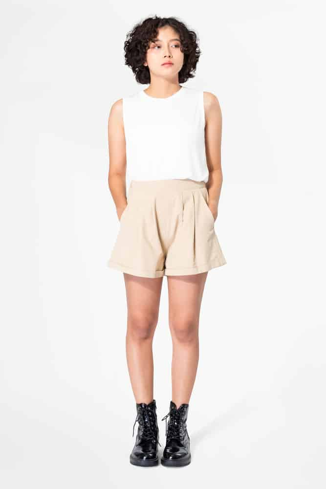 A woman wearing a pair of pleated shorts.