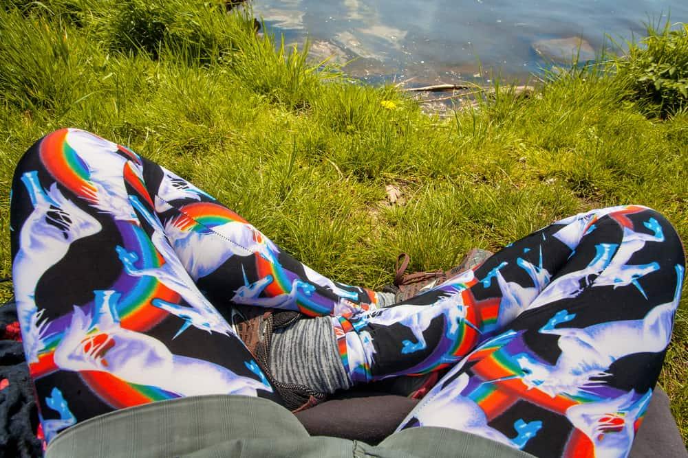 A man on a hike wearing a pair of unicorn print yoga pants.