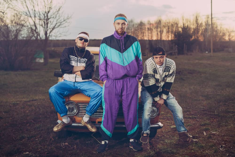 This is a close look at three friends wearing 90s-inspired outfits.