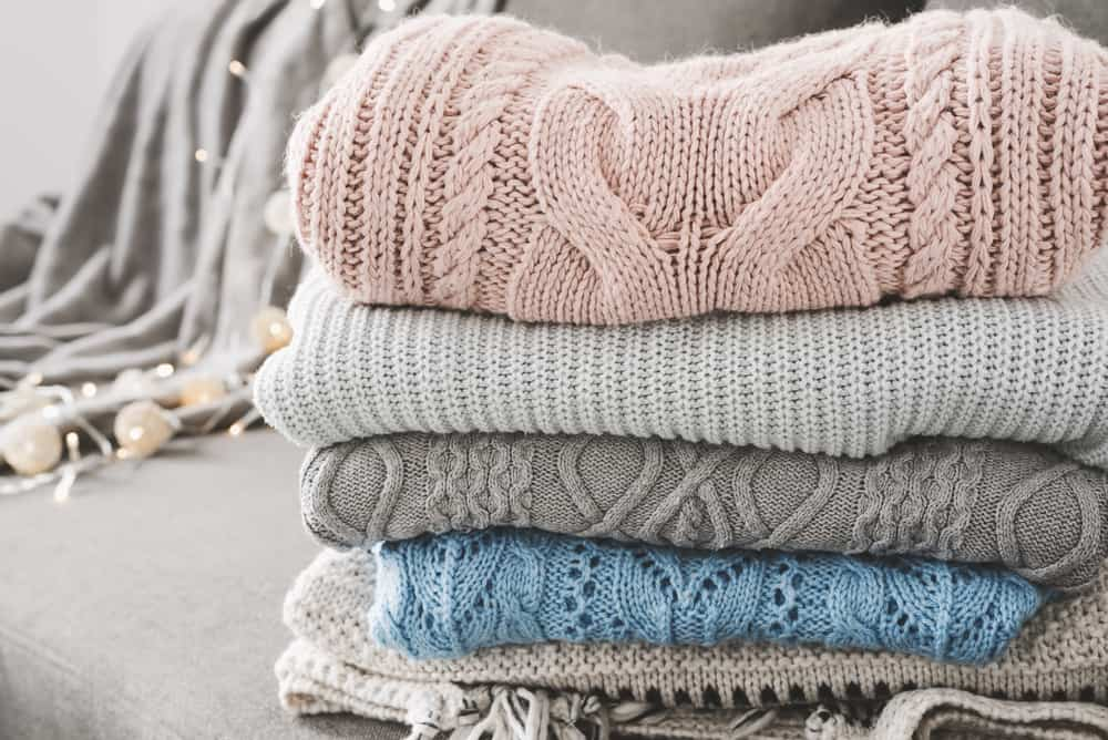 This is a close look at folded and stacked cashmere sweaters.
