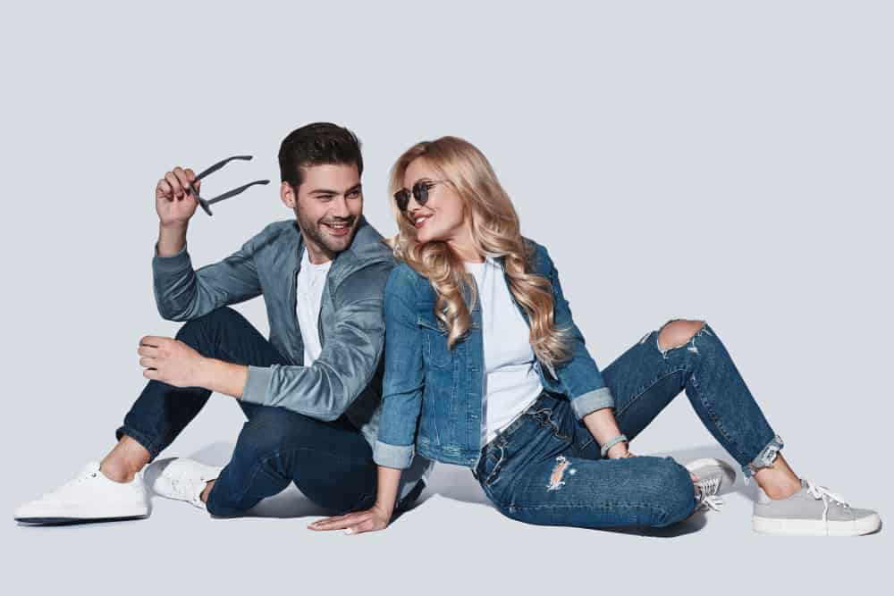 A man and a woman both wearing jeans and jackets.