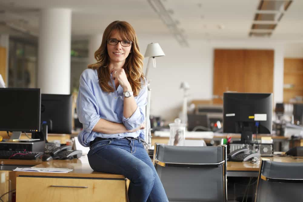 This is a woman wearing a pair of jeans in an office setting.
