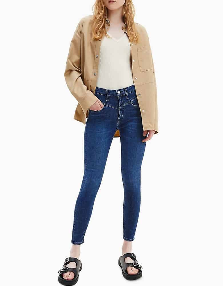 The High Rise Super Skinny Mid-Blue Ankle Jeans from Calvin Klein.