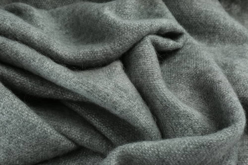 This is a close look at a gray cashmere wool scarf.