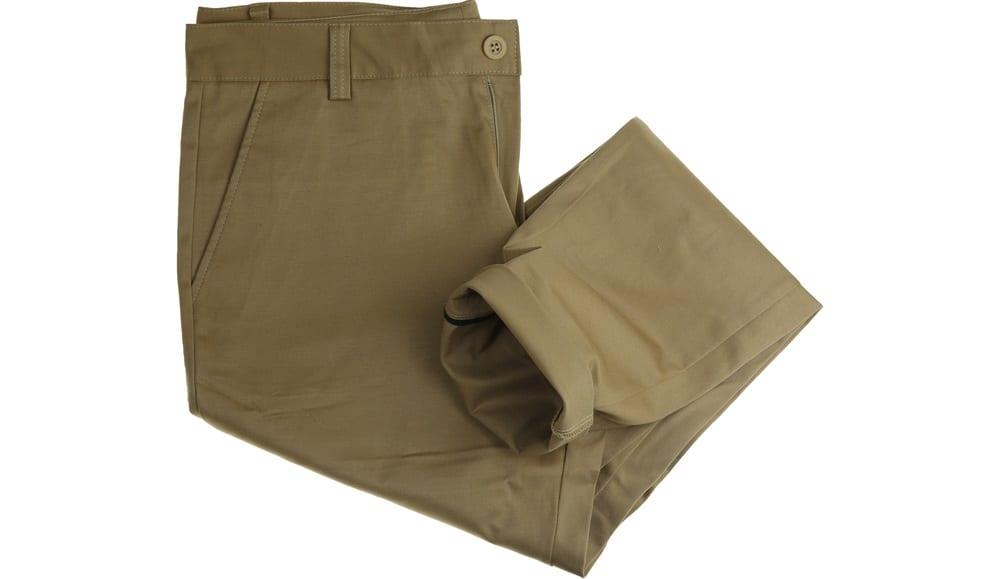 A close look at a pair of green chino pants.