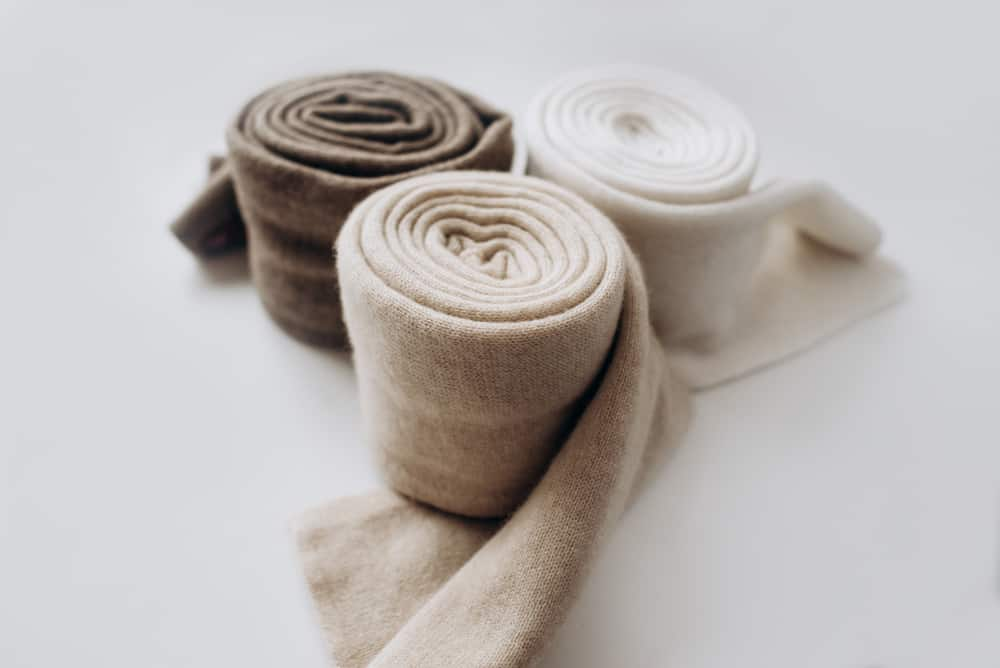 A close look at rolls of cashmere scarves.