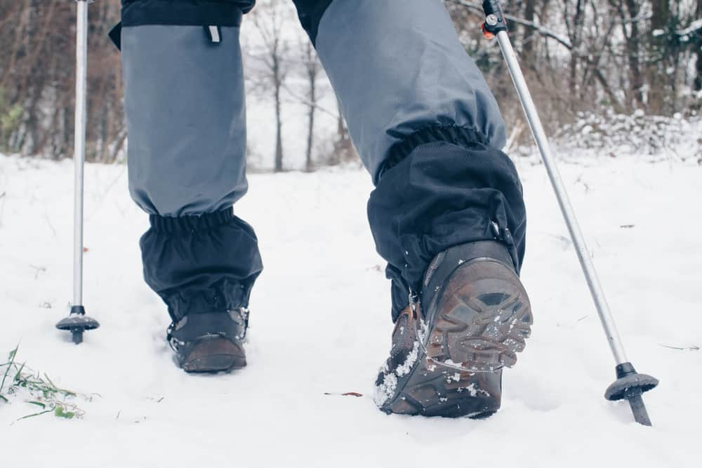 This is a close look at a snow hiker wearing a pair of gaiters.