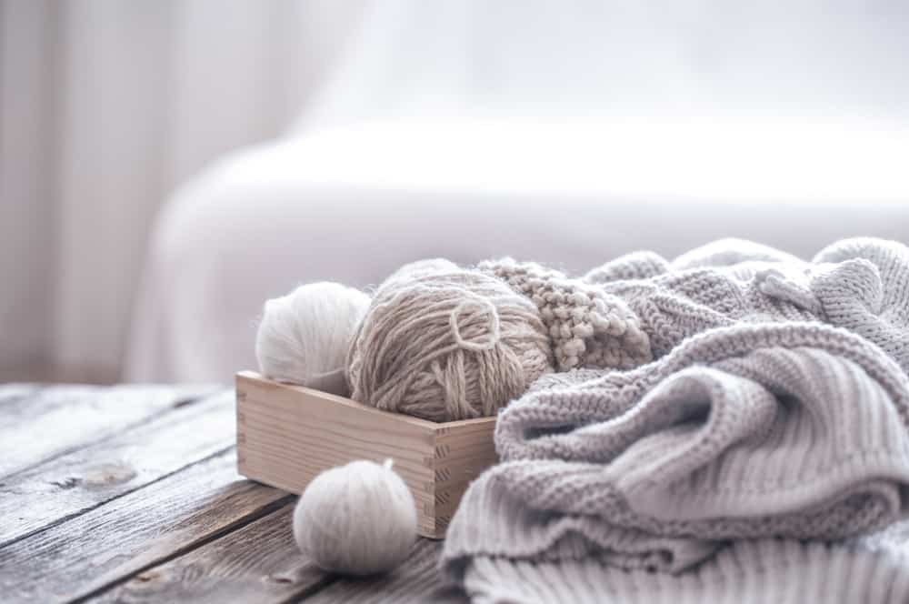 A close look at knitted sweaters and balls of yarn.