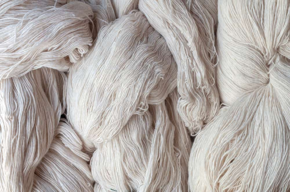 This is a close look at a bunch of raw yarn cotton materials.