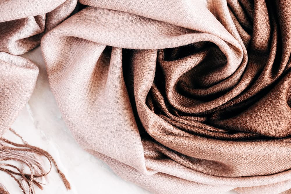 A close look at a brown crumpled cotton scarf.