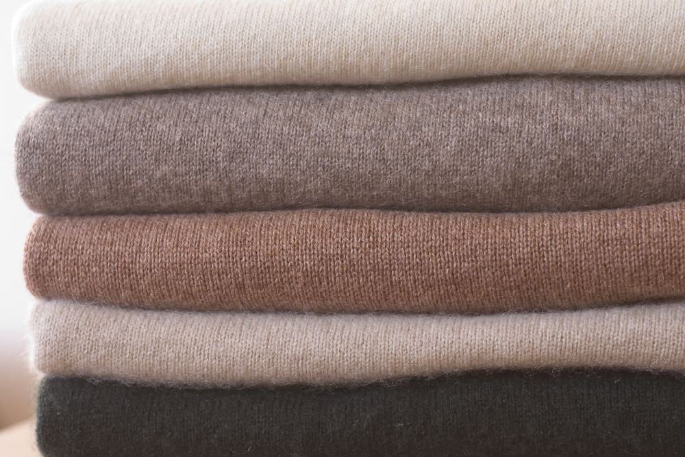 This is a close look at a stack of cashmere sweaters.
