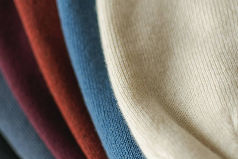 A close look at a variety of colorful cashmere hats.