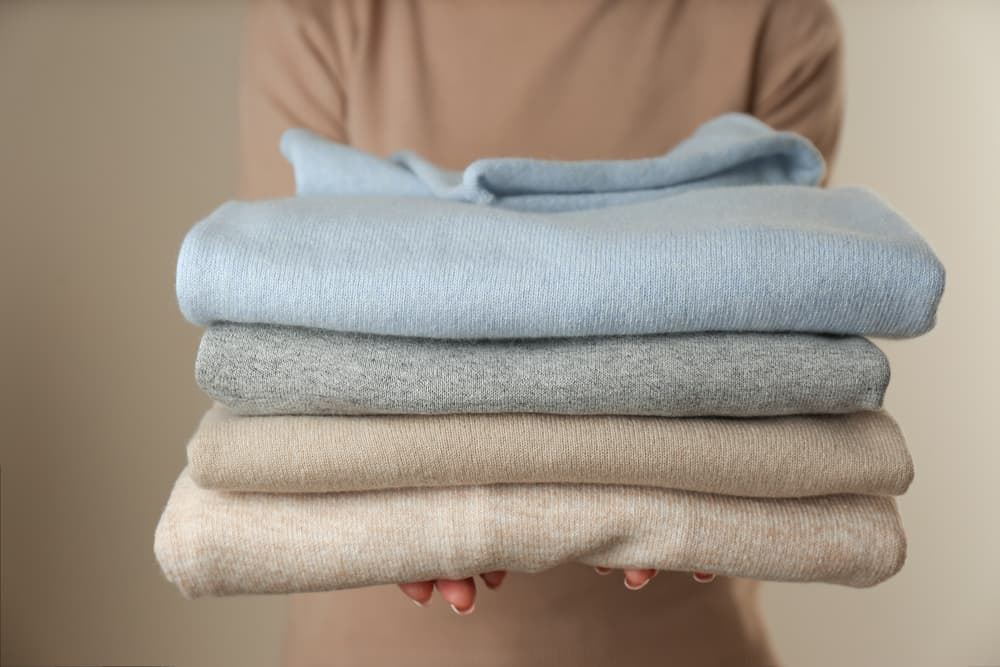 A stack of pastel-toned cashmere sweaters.
