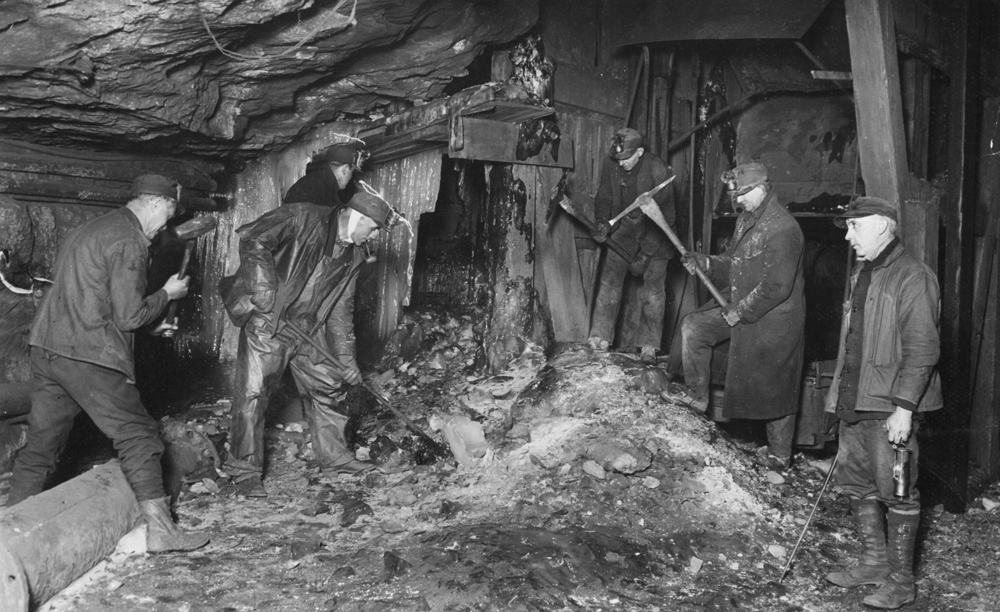Coal miners wearing cotton pants.