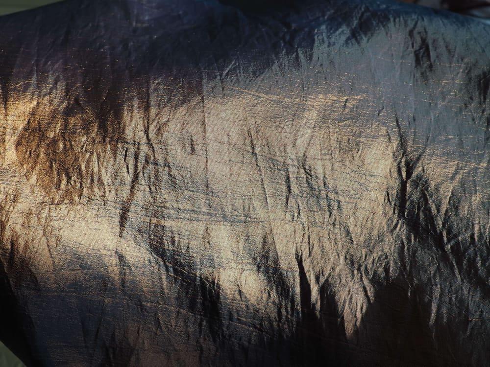 This is a close look at a black silk taffeta cloth.