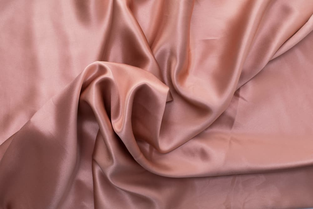 This is a close look at a pink crumpled Mulberry Silk.