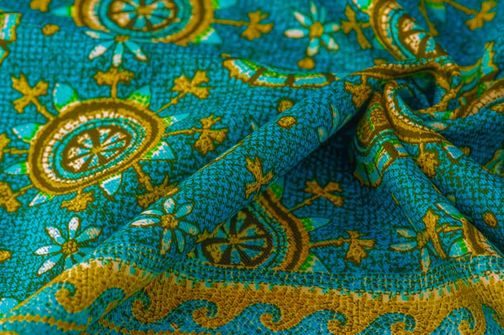 This is a piece of colorful and patterned charmeuse silk cloth.