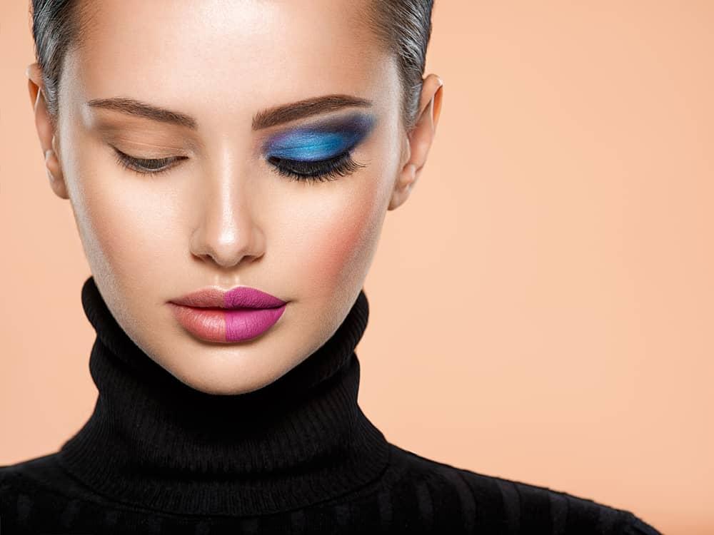 Woman with a half face makeup.