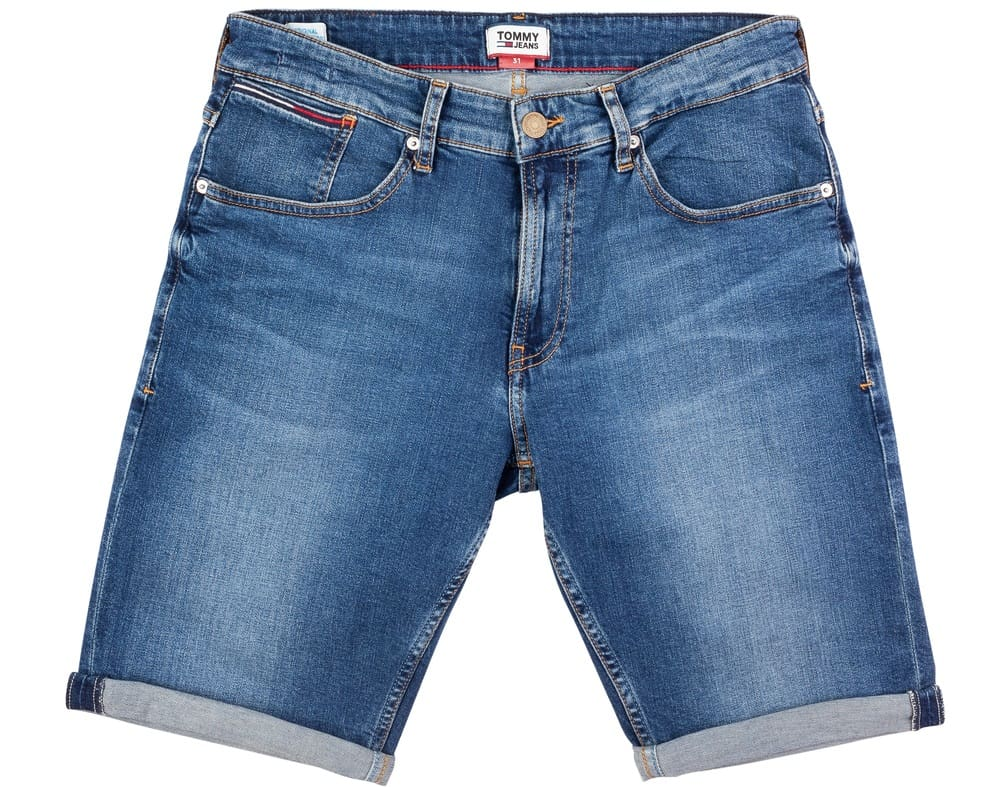 This is a close look at a pair of long denim shorts with cuffs.