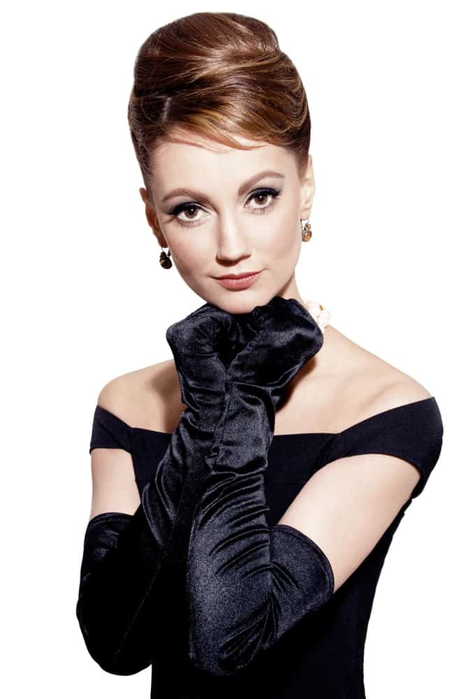 This is a woman wearing a black dress with black gloves.
