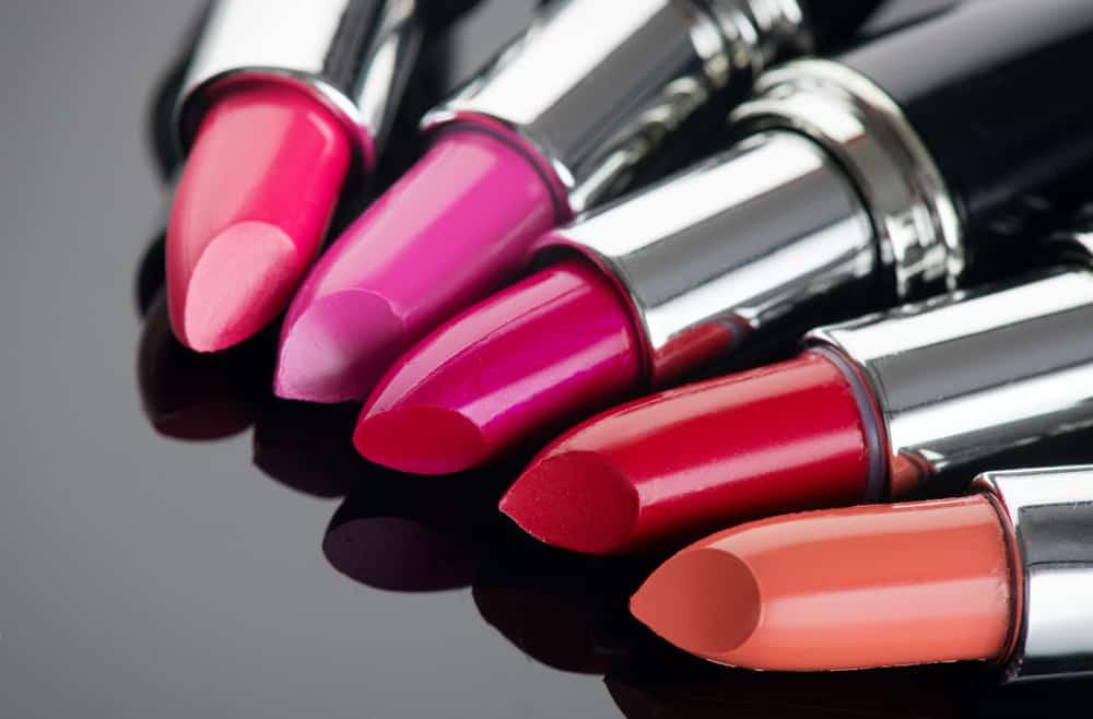 Lipstick tints palette against a black background.